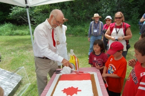 Councillor Avery cuts the Canada Day cake!
